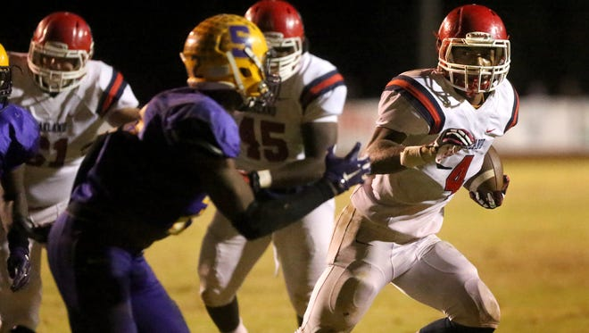 Oakland'sLazarius Patterson (4) runs the ball as Smyrna's AJ Carter (3) moves in to stop Patterson during the game at Smyrna, on Friday Oct. 30, 2015.