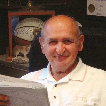 Ed Puglisi working at Puglisi Tax Service, where he