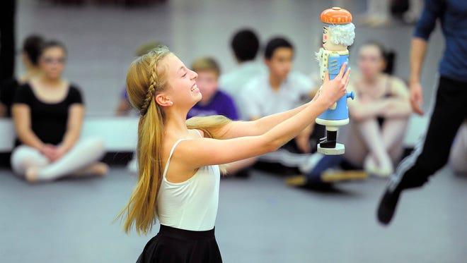 "Francesca Moore, 14, rehearses the part of Clara for Nashville Ballet's production of ""Nashville's Nutcracker"" on Nov. 13. Moore is among the 191-member youth cast, the largest to date for the annual holiday production\."