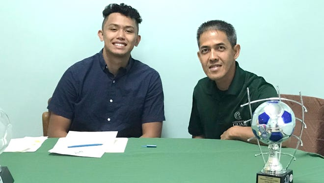Kyle Duenas, left, signing his University of Guam letter of intent with UOG men's soccer coach Rod Hidalgo.