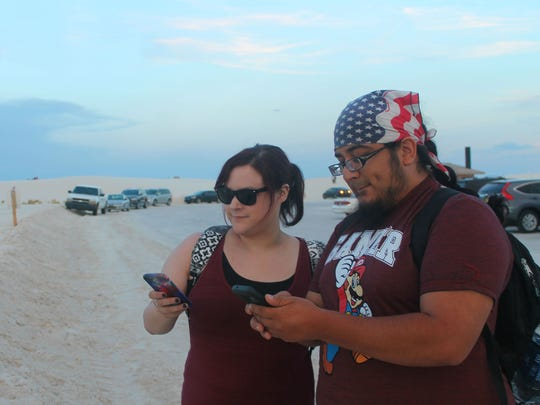 Candace Taylor and Steve Medina were two of many visitors drawn to White Sands National Monument on Wednesday night in the pursuit of Pokémon.