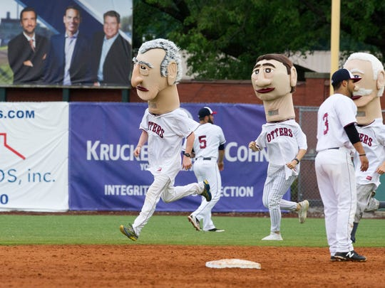 "Kieth Millikan, left in the William Henry Harrison head leads the ""Evansville Legends"" race during a baseball game at Bosse Field on Saturday, May 19."