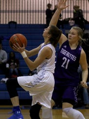 City View's Maddie Chalenburg attempts a layup while