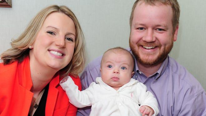 Meet the Binzer family. Mom Katie, dad Zach, and baby Annabelle.