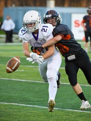 Albany wide receiver Johnny Goehring, 21, can't get