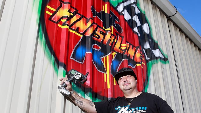 Jeremy Vigil, owner of Finish Line RC, stands in front of his business on Oct. 25 at 1111 Hines Road in Farmington. Vigil is holding an event that will allow people to race for free if they bring food items that will be donated to a food bank.