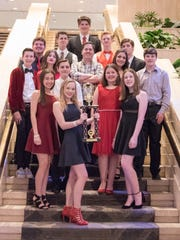Stage Center actors hold their trophy for Excellence