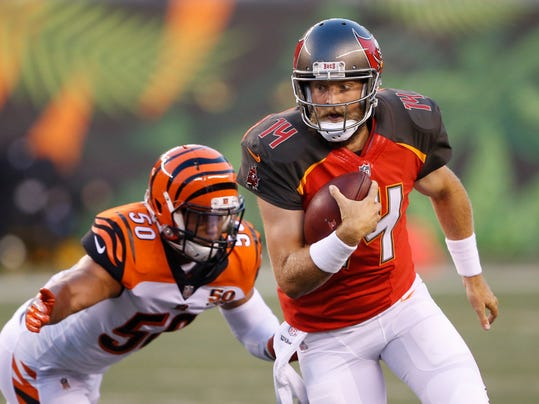 Tampa Bay Buccaneers quarterback Ryan Fitzpatrick (14) runs the ball in front of Cincinnati Bengals linebacker Jordan Evans (50) diromg the first half of a preseason NFL football game, Friday, Aug. 11, 2017, in Cincinnati. (AP Photo/Gary Landers)