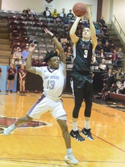 Hardin-Simmons' Caleb Spoon is fouled by McMurry's
