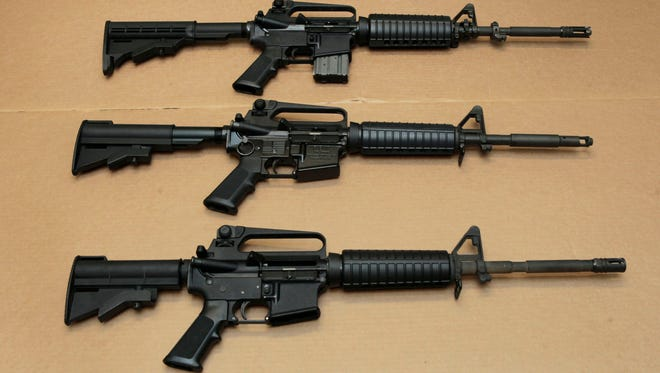 Three variations of the AR-15 assault rifle.