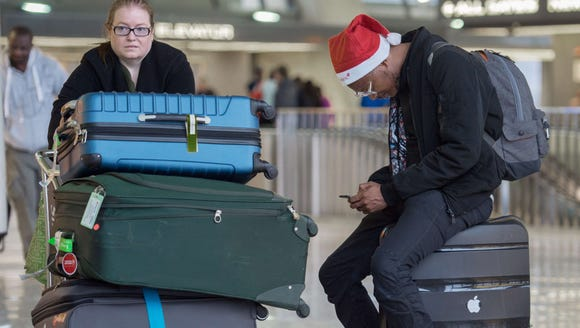 Holiday travelers at Dulles International Airport on