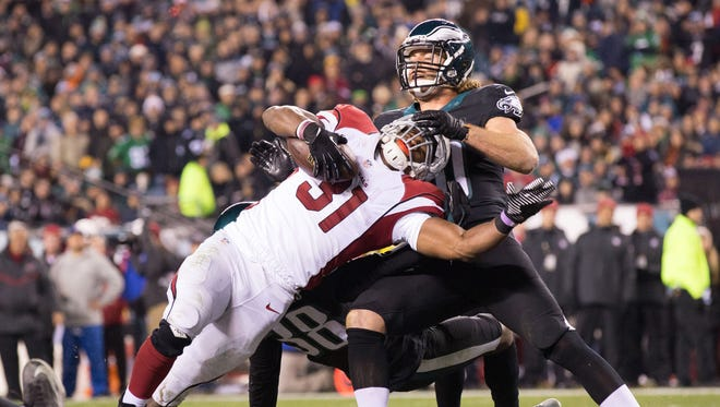 Dec 20, 2015: Cardinals running back David Johnson (31) scorers a touchdown past the tackle attempt of Philadelphia Eagles linebacker Kiko Alonso (50) during the third quarter at Lincoln Financial Field.