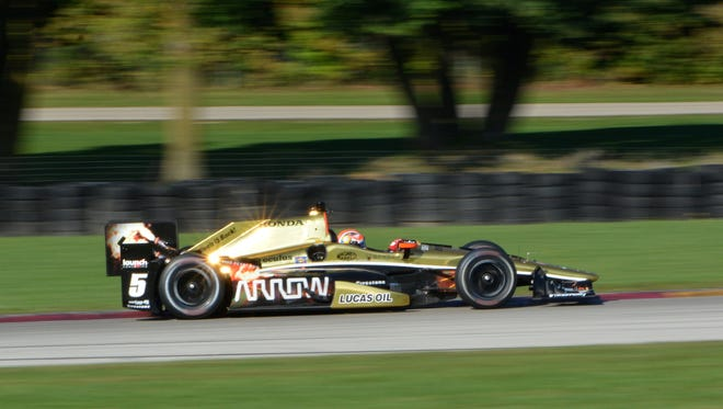 James Hinchcliffe exits Turn 3 at Road America during a test in 2015. The session was Hinchcliffe's first time on track since suffering life-threatening injuries in a crash May 18 at the Indianapolis Motor Speedway.