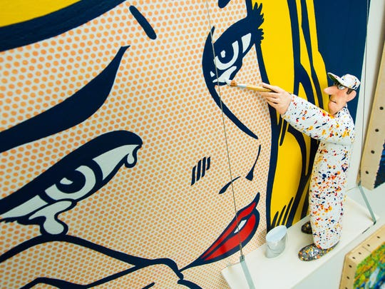 """In Stephen Hansen's """"Great Moments in Art"""" series, a small papier-maché painter steps into the worlds of famous artists. Here, Hansen's creative little guy adds a tear to """"Lichtenstein's Crying Woman."""""""