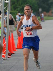 Doug Butler, seen in this 2007 file photo, doesn't train in the heat during the summer. He prefers early mornings before the temperatures get out of hand.