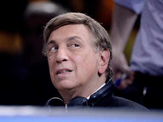 Television personality Marv Albert looks on during