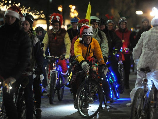 Cyclists attend the annual Tour de Lights bike ride in downtown Knoxville. The event will take place on Friday, Dec. 15.