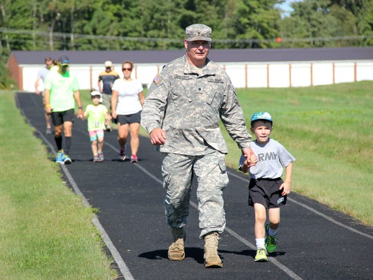 Parents and guardians brought up the rear with a few children in the kids' 1-mile race at Camp Johnson in Colchester on Sunday. The race was part of the larger Vermont Remembers Run.