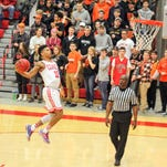 Olivet College men's basketball wins first MIAA crown since 1973