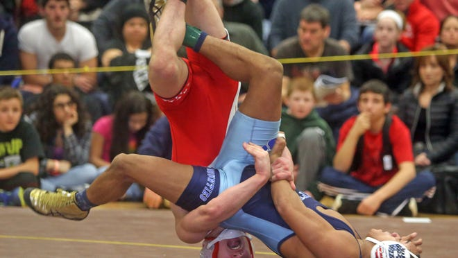 Daiton Powell, right, of Suffern defeated Matt Grippi of Fox Lane 2-1 to win the 132-pound title Sunday at the Division 1 sectional wrestling championships at Clarkstown South High School. Powell scored his only points on a move with three seconds left in the match.