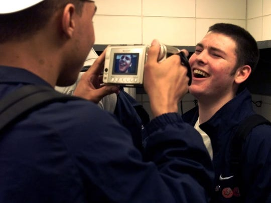 3/17/01.  Nick Gardner guard with the Butler Bulldogs right is the subject of an interview by teammate Joel Cornette in a light moment in the team's locker room following practice.  Cornette asked questions about his fictional brother Jason Gardner guard with Arizona.  (Robert Scheer Photo) w/story file 57280 slug: practice18