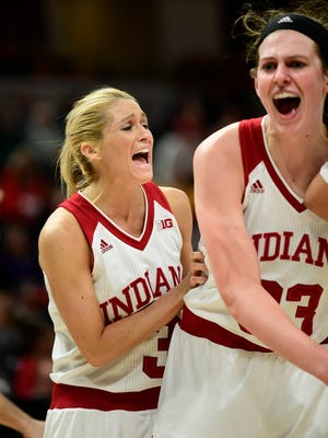 Indiana Hoosiers guard Tyra Buss (3) and Indiana Hoosiers forward Amanda Cahill (33) react to a call in the third overtime during the second round of the Big Ten Conference Tournament at Bankers Life Fieldhouse. Indiana defeated Michigan State 111 to 109 after 4OT.