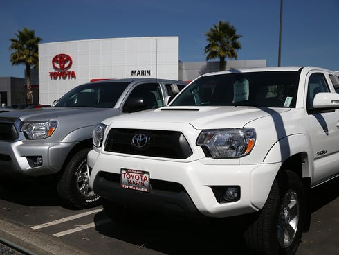 Brand new Toyota trucks are displayed at Toyota Marin in San Rafael, Calif.