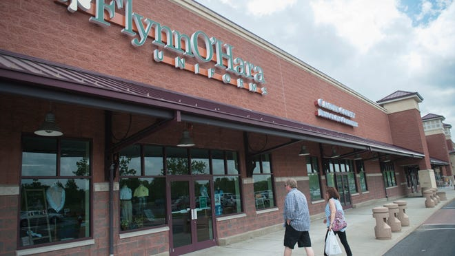 The entrance of Flynn & O'Hara Uniforms' new location at the Garden State Pavilions (below) on Route 70 in Cherry Hill. The store has moved after more than 20 years at a Mount Ephraim shopping center.