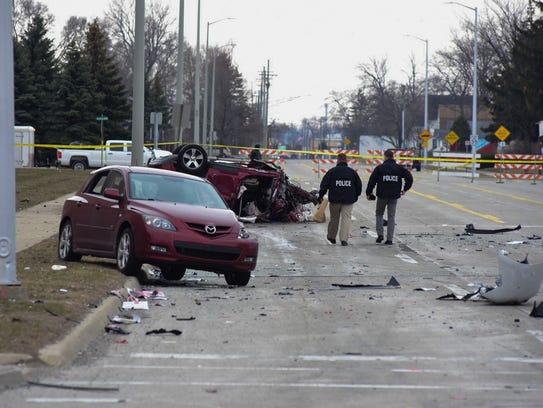 Investigators remain at the scene of a fatal crash