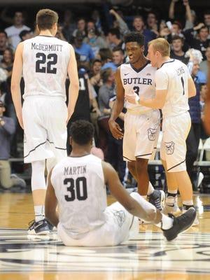 Butler guard Kamar Baldwin(3)  celebrates with teammates after hitting the game-winning shot to beat Northwestern.