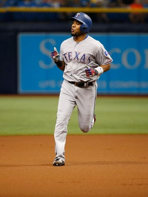 Texas Rangers shortstop Elvis Andrus (1) reacts as he runs around the bases after hitting a home run during the first inning against the Tampa Bay Rays at Tropicana Field.