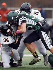 Marlboro High School's Sam Galage, left, and Rob Papuli, top, wrap up Schalmont's Nick Gallo on Saturday in Kingston.