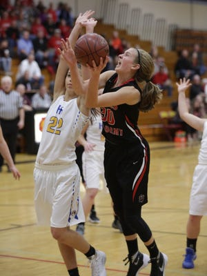 Lourdes Academy's Katie Van Scyoc (30) puts up a shot against Howards Grove during a WIAA Division 4 sectional semifinal at West Bend.
