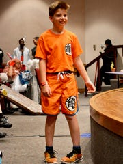 A cosplayer shows off their costume at the Animania
