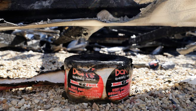 A roll of labels lies among the remnants of Don's Specialty Meats, following a devastating fire, in Carencro Oct. 3, 2016.