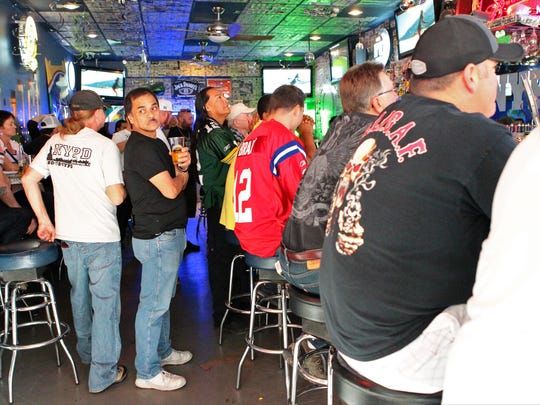 People are packed into the bar area of NYPD to watch Super Bowl XLIX during the first half on Sunday, February 1, 2015 in downtown Palm Springs.