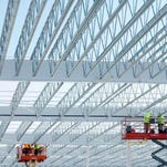 Workers at the Costco building under construction at CityGate in Rochester, N.Y. on Tuesday, November 18 2014.