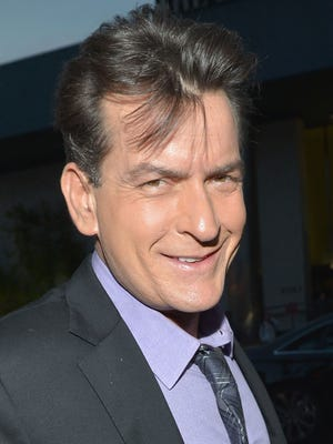 Actor Charlie Sheen arrives at the premiere of 'Scary Movie V' presented by Dimension Films, in partnership with Lexus and Chambord at the Cinerama Dome on April 11, 2013 in Los Angeles.