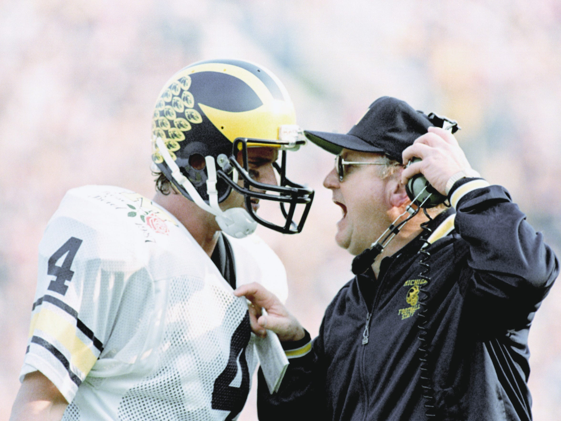 Michigan head coach Bo Schembechler yells at quarterback