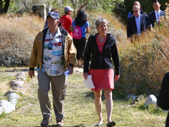 Interior Secretary Sally Jewell and Route 66 historian Jim Conkle walk toward a tent at the Whitewater Preserve, where conservationists celebrated three new national monuments in the California desert on May 5, 2016.