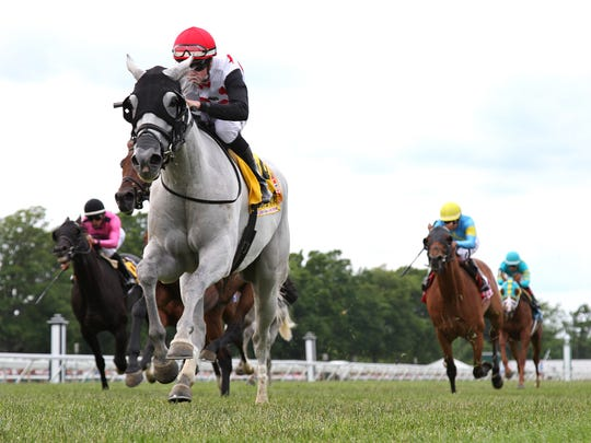 World Approval, with Florent Geroux riding, leads the field to the wire Sunday in winning the Grade I $300,000 United Nations Stakes at Monmouth Park
