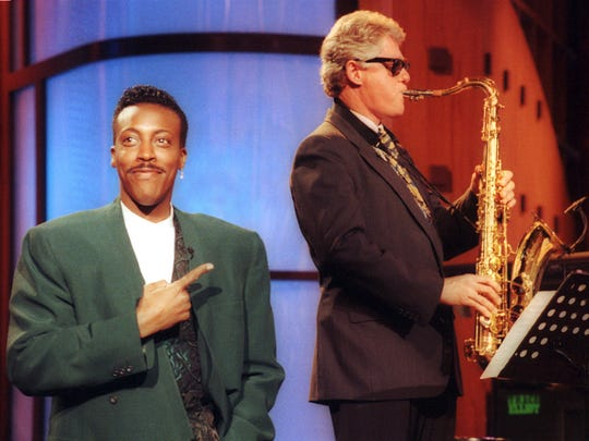 "In this June 3, 1992 file photo, Bill Clinton plays the saxophone during a campaign stop on ""The Arsenio Hall Show"" in Los Angeles as host Arsenio Hall stands by."