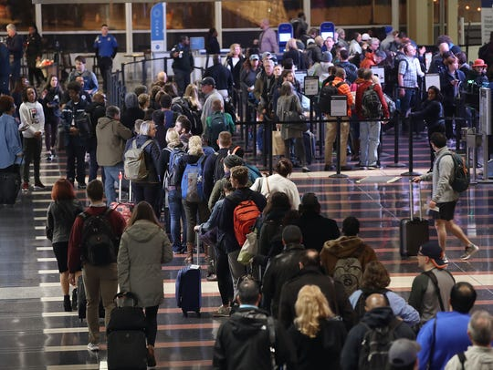 Travelers should continue to monitor their flight status as the day (and weekend) continues.