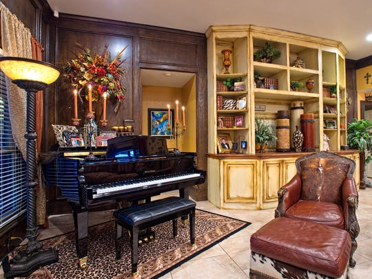 The grand piano is a great addition in a cozy corner