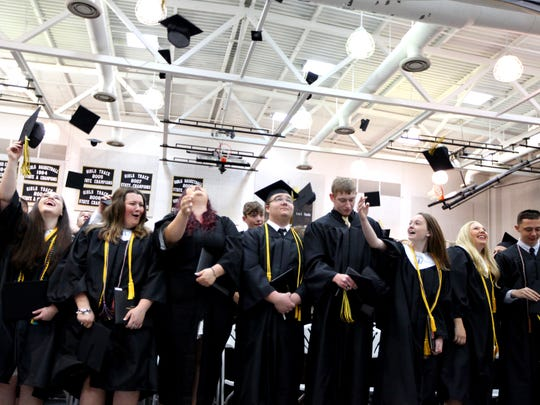 Graduates toss their caps at the conclusion of Buffalo
