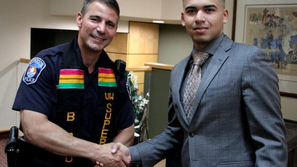 black student union kente ceremony police chief u wisconsin superior