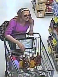 A surveillance camera captured this image of a woman suspected of stealing $980 of alcohol from an Oak Creek grocery store.