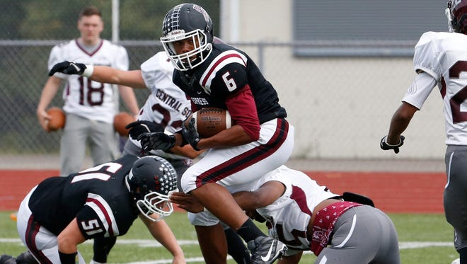 Elmira's Allaah Sessions carries against Central Square during an 80-8 home victory on Sept. 19.