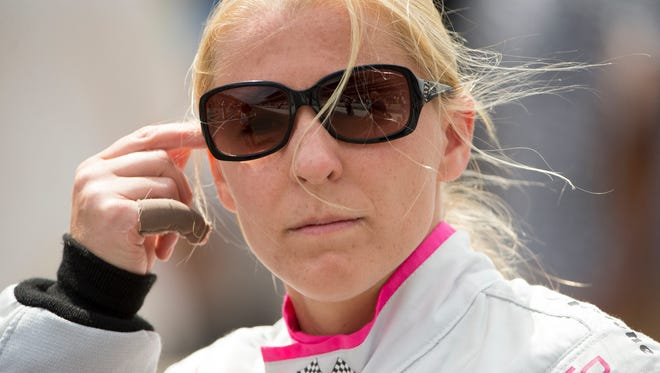 Pippa Mann heads to her car, before the Indy 500 race, at Indianapolis Motor Speedway, Sunday, May 28, 2017.