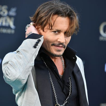 Johnny Depp arrives for the premiere of 'Pirates of